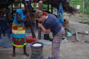tourist wit local stamping cassava